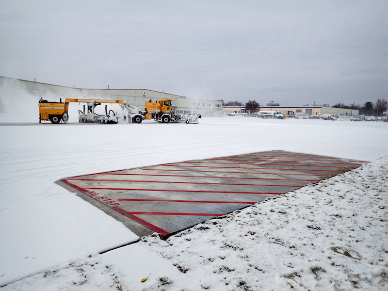 Iowa State engineers don't need a plow to clear snow from the heated test slabs they installed at the Des Moines International Airport. Credit: Halil Ceylan