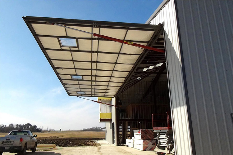 Hydraulic one-piece doors swing outward from your building forming a canopy when wide open.